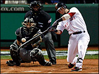 Boston's Dustin Pedroia hits a lead-off home run in the World Series opener against Colorado