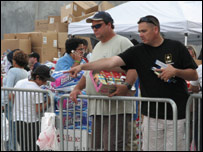 Handing out supplies at Qualcomm Stadium
