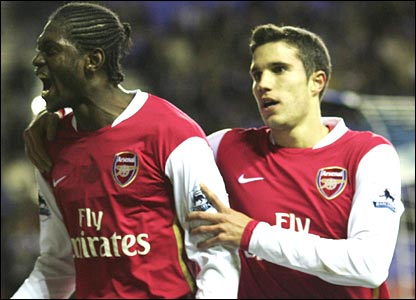 Emmanuel Adebayor and Robin van Persie