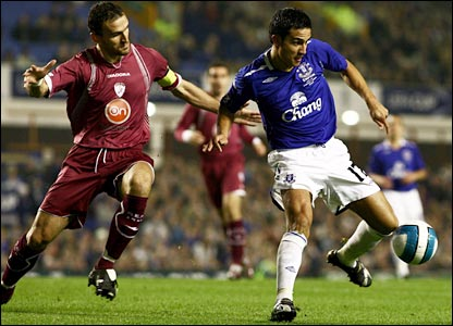 Ex-Newcastle star Nikos Dabizas cannot stop Tim Cahill putting the Toffees ahead