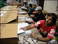 Buenos Aires postal workers prepare ballot boxes