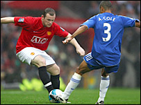 Manchester United's Wayne Rooney takes on Chelsea's Ashley Cole