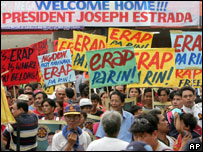 Supporters of former President Joseph Estrada display placards as they wait for his arrival Friday, Oct. 26, 2007 in San Juan east of Manila, Philippines.