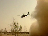 A helicopter flies above the scene after a US soldier is shot