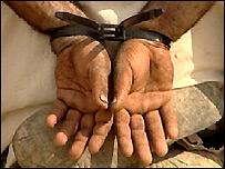 A handcuffed prisoner