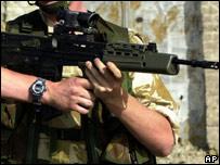 A British soldier with a gun