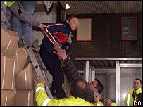 Stowaway helped from lorry