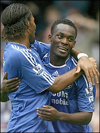 Michael Essien (r) celebrates the opening goal with Didier Drogba