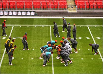 Miami walk through their plays on the Wembley field