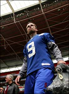 Lawrence Tynes steps out onto the Wembley turf with his practice balls