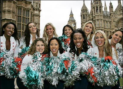 Dolphins cheerleaders in front of the Houses of Parliament