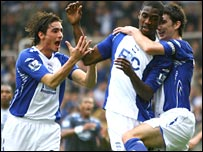 Olivier Kapo is mobbed by team-mates after scoring Birmingham's winner