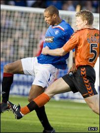 Rangers' Daniel Cousin holds off Darren Dods' challenge
