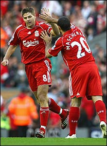 Gerrard is congratulated by Liverpool team-mate Javier Mascherano