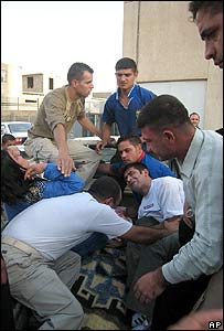 Injured people are removed from the scene of the Kirkuk blast, 28 October 2007