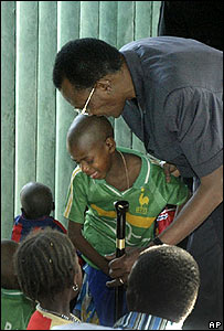 Chadian President Idriss Deby visits the children in an orphanage in Abeche on 26 October