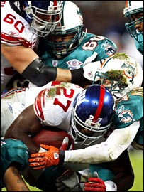 NY Giants running Back Brandon Jacobs tries to break through the Miami defence at Wembley.