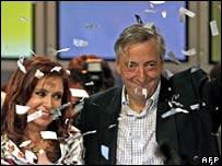 Cristina Fernandez de Kirchner and Nestor Kirchner greet supporters