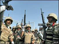 Iraqi soldiers celebrate handover