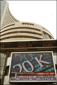 A sign marks the Sensex hitting 20,000 points