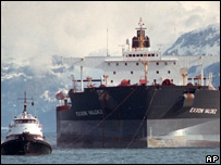 Exxon Valdez being pulled by tugboats to shore