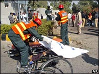 Pakistani rescue workers at the scene of the Rawalpindi bombing, October 30 2007