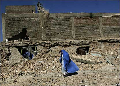 A worker and a woman in Kabul