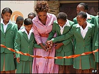 Cutting the ribbon to open the Oprah Winfrey academy in Jan 2007