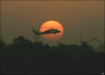 A US Army Black Hawk helicopter flies over Baghdad