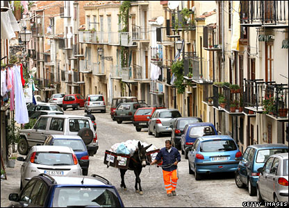 A municipal worker and his donkey collect rubbish in Sicily