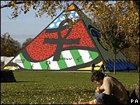 The artist, Romero Britto, seated near the pyramid in Hyde Park
