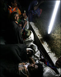 Women sleeping on the road in India