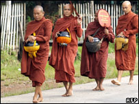 Monks beg for alms north of Rangoon. 12 October