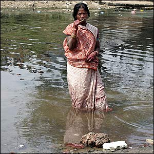 Woman cleaning her teeth in the state of Orissa