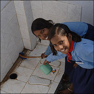 Girls cleaning a latrine in the state of Uttar Pradesh
