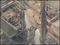 Firefighters tackling refinery fire