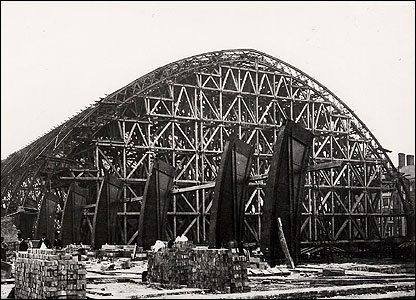 A vintage photograph of the train shed under construction
