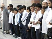 Muslims line Whitechapel High Street outside the East London Mosque (London Muslim Centre) Thursday July 14, 2005