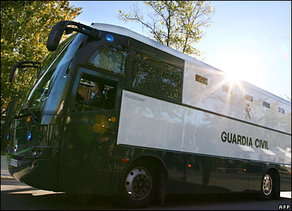 A Guardia Civil (police) bus carrying the Madrid train blast accused arrives at the National Audience court in Madrid