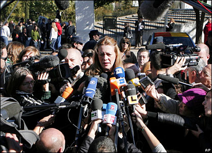 Pilar Manjon, president of 11 March Association for the Victims of Terrorism, speaks with journalists outside the court