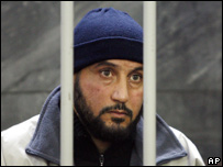 Rabei Osman Sayed Ahmed stands behind bars in a Milan court, Nov. 6, 2006