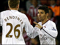 Eduardo (right) celebrates with Nicklas Bendtner