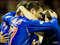 The Rangers players celebrate Nacho Novo's opener