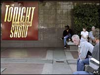 Fans of NBC's The Tonight Show wait to get inside the studio on Wednesday, as a deadline looms for writers to agree a new contract with the studios