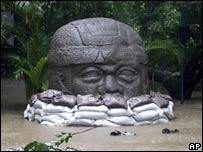 An Olmec head partially underwater in Villahermosa, eastern Mexico,