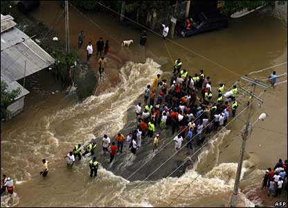 People try to leave flooded areas of Villahermosa