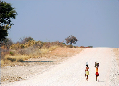 Girls walking along rural road