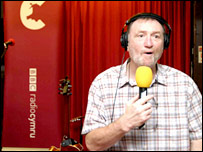 Gravell working as a BBC broadcaster