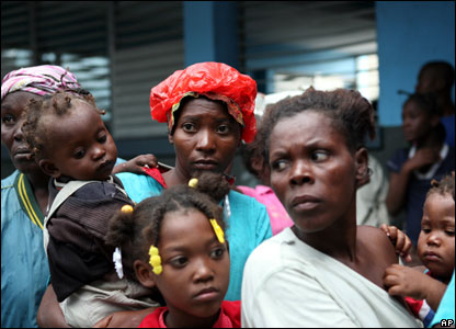 Refugees line up to get food and supplies from UN peacekeepers at a school in Cite Soleil, Port-au-Prince, 31 October