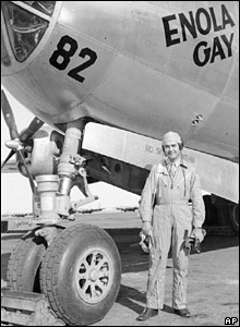 Paul Tibbets standing in front of Enola Gay, 1945